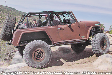 A Jeepster fully modified to tackle Area BFE at Moab, Utah