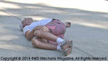 Volunteer 4x4 driver Jake Munoz stretches before Rubicon Trail day.
