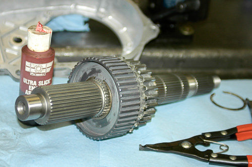 New output shaft assembly begins with sprocket.