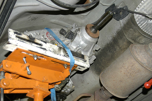 Use of a transmission jack and straps when removing the 231 transfer case.