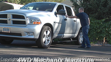 PowerBoard by Bestop enhances function and appearance of this Ram 1500 4x4 pickup.