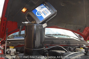 Gallon bottles and a 5-quart filler can speed fill of the three gallon capacity 5.9L diesel with a new filter.
