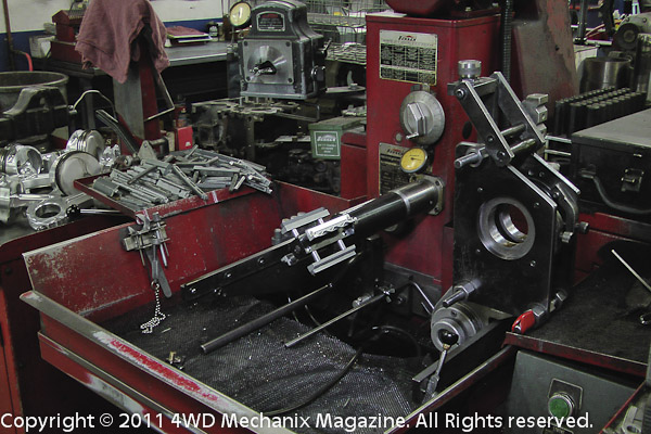 Hone works on small and big end of rods or jobs as large as motorcycle cylinder honing.