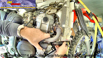 Upper engine tear down begins with exhaust system.