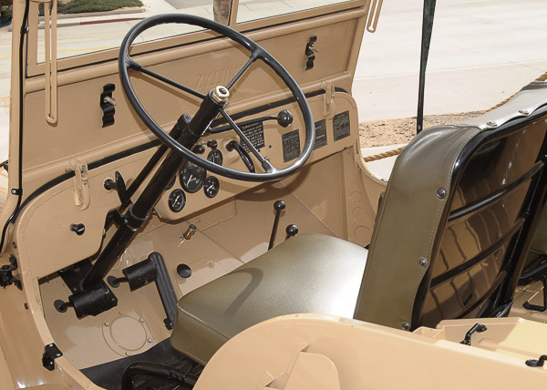The earliest serial number CJ-2A models came with column shift transmissions. This quickly gave way to the distinctive cane shifter.