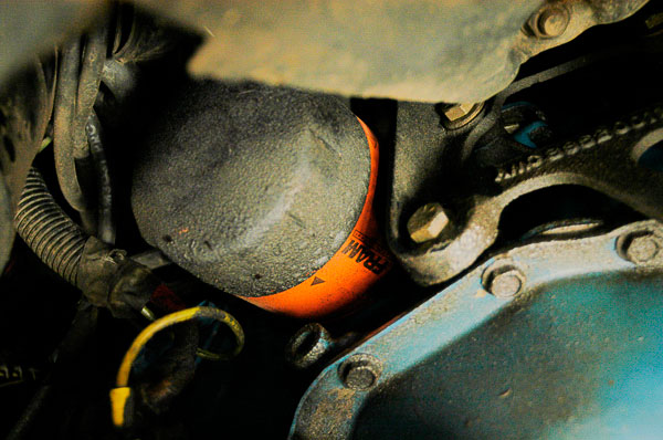 Finding the Jeep engine's oil filter.