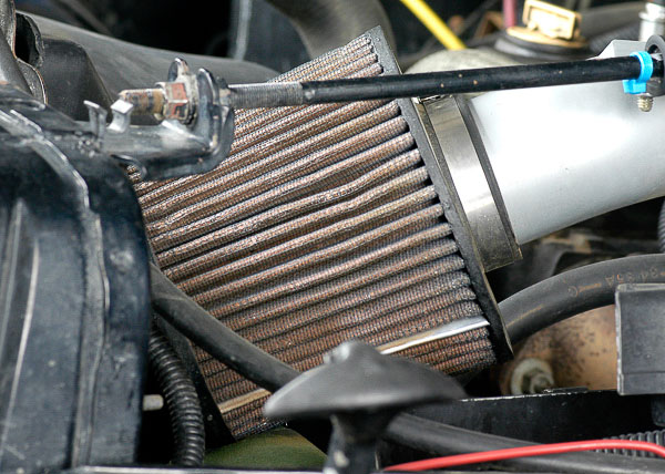 Aftermarket, low-restriction air filter and intake tube.