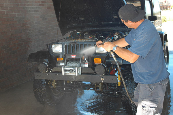 Son-in-law Kevin is an avid four-wheeler. Here, he sprays cleans his YJ Wrangler before service.
