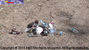 Trash and debris discarded on public lands.
