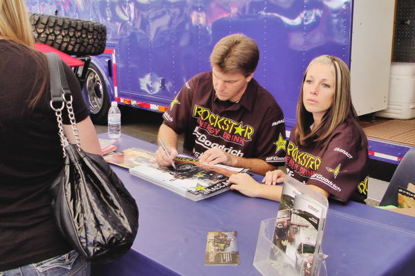 Rob MacCachren signs posters at 2011 Off-Road Expo