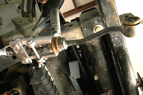 Use of puller to remove stabilizer bar studs.
