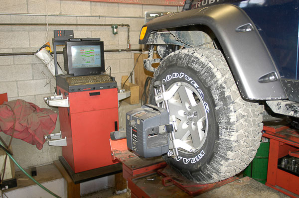 Complete four-wheel alignment and center steering wheel.