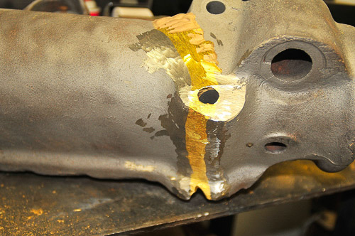 Restoration of a large iron casting with former brass repair.