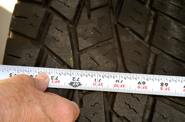 Confirming toe-in measurements at front tires.