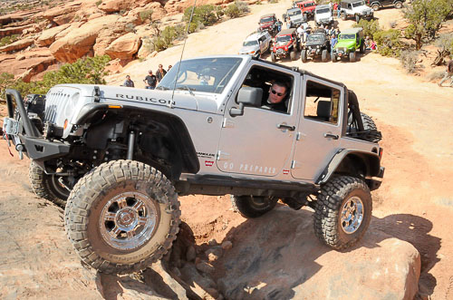 JK Wrangler scaling a rock wall at Moab EJS 2010