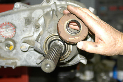 Oil slinger at rear of transfer case on output shaft.