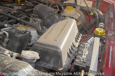 The air box is easy to locate on this Jeep XJ Cherokee, similar to the Wrangler air boxes.