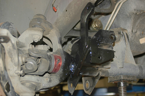 Long sway bar link brackets furnished with suspension kit.