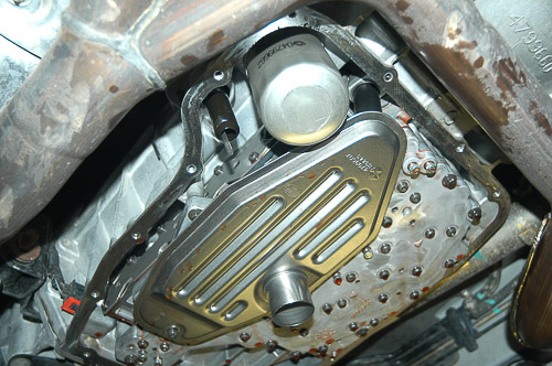 Typical Jeep transmission filters use a retaining screw; 45RFE also uses a spin-on type.