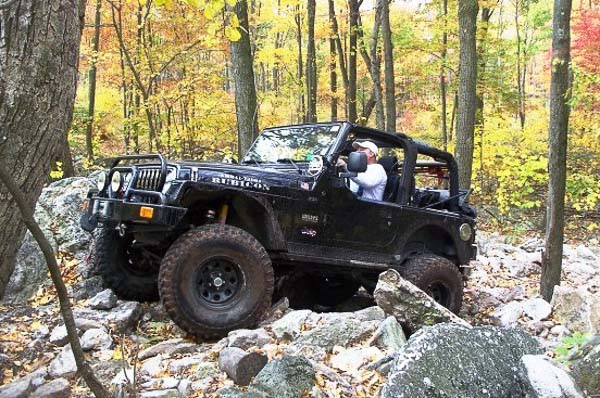 Al Handy and the black TJ Wrangler Rubicon in the woods!