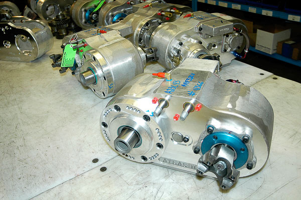 Beautiful Bench Full Of Atlas II Transfer Cases At The Advance Adapters Machine Shop.