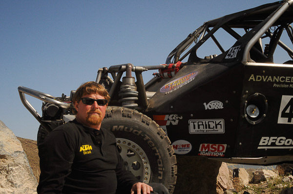 Bradley Falin alongside his Ultra 4 #457 desert race car
