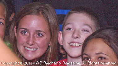 Camp Wamp Kid (center) surrounded by enthusiast staff at the dance.