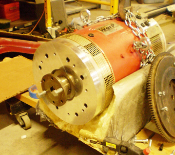 DC electric motor has custom drive flange for flywheel