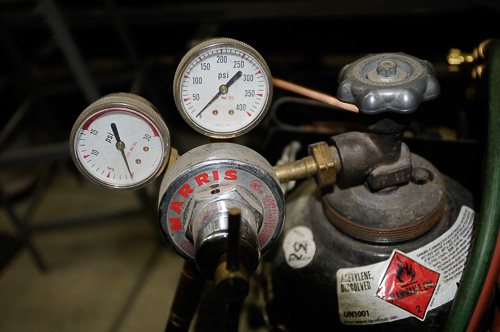 Two-stage regulators fit atop the oxygen & acetylene bottles