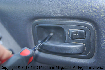 Look the door panel over thoroughly for screws.