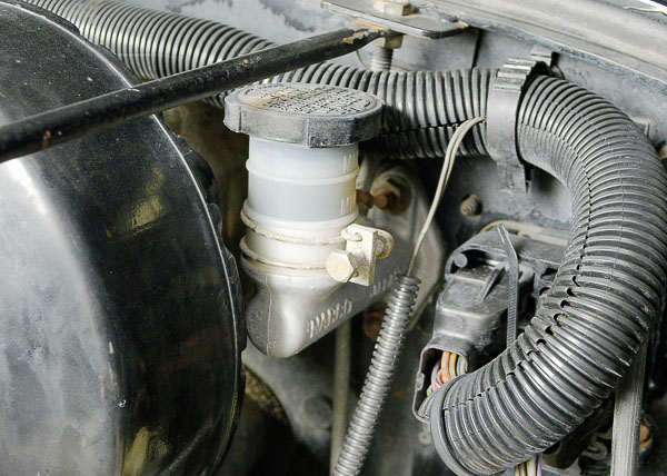 Clutch master cylinder on a Jeep Wrangler.