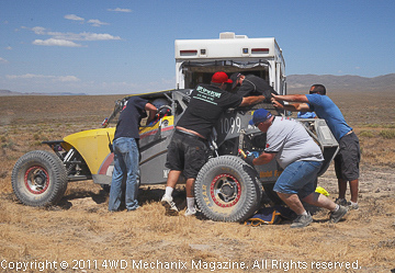 Pit Two action as a crew in the remote desert races to get the car back into action!