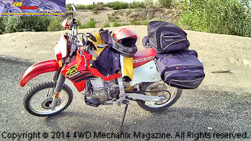 Honda XR650R dual-sport motorcycle fully loaded for HD video filming at rural Nevada