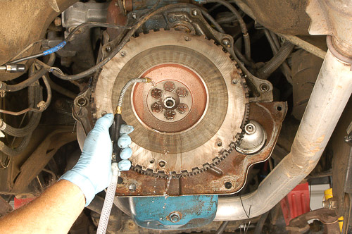Using brake washer to clean off Jeep flywheel.
