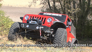 Jeep JK Wrangler pulling itself with the new Zeon winch!