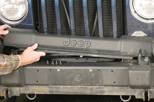 Remove Jeep TJ Wrangler cover over stabilizer bar.