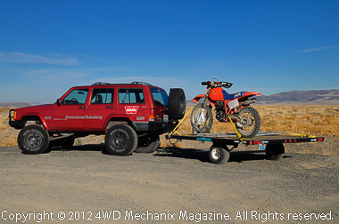 XJ Cherokee pulls motorcycle trailer with XR350R on board.