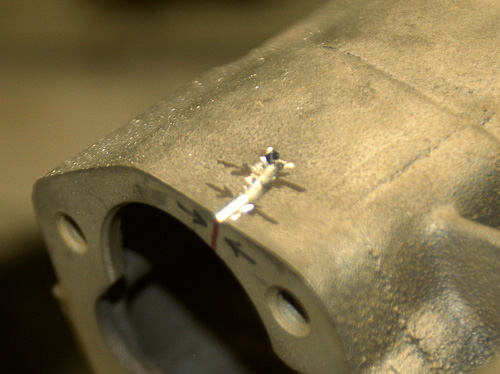 Find crack ends and drill holes to stop spreading of crack after weld repair.