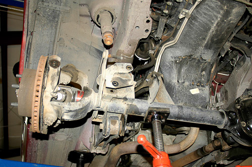 Lowering axle to relieve spring loads.
