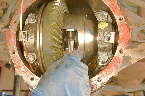 Install axle shafts and C-clips, checking clearance between spacer pin and axle shaft ends.