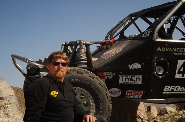 Bradley Falin alongside his Ultra 4 #457 desert race car