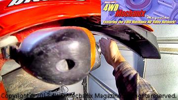 Exhaust valve leak detected at Honda XR650R tailpipe.