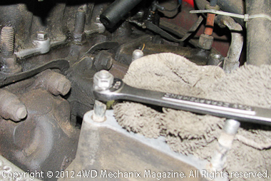 Double-nut method for removing intake manifold studs