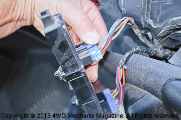 Unclip the harness plugs.