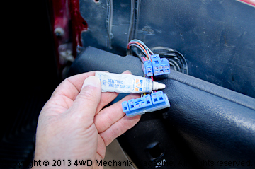 Use dielectric grease on the plug terminals.