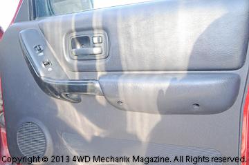 Door panel back in position, all screws installed.