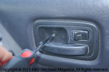 look the door panel over thoroughly for screws