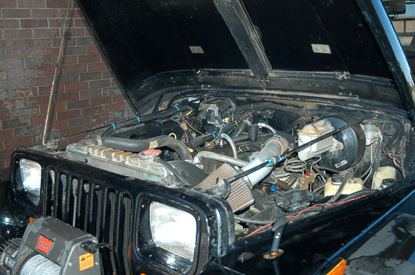 Underhood of YJ Wrangler at the car wash.
