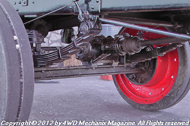 Rear beam axle with driveshafts above the beam