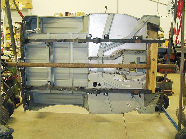 CJ-2A body tub undergoing a rotisserie restoration